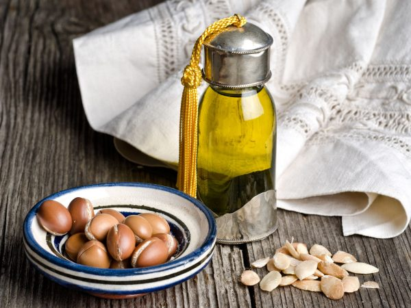 16002846 – bottle of argan oil and argan fruit. argan oil is used for skincare products.