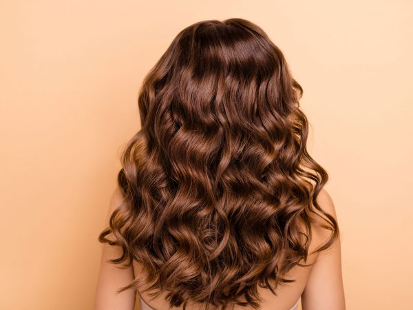 Back rear side photo of charming girl show perfect strong wellness, hairstyle hairdo after hairdresser therapy coiffure have professional hair coloration isolated over pastel color background