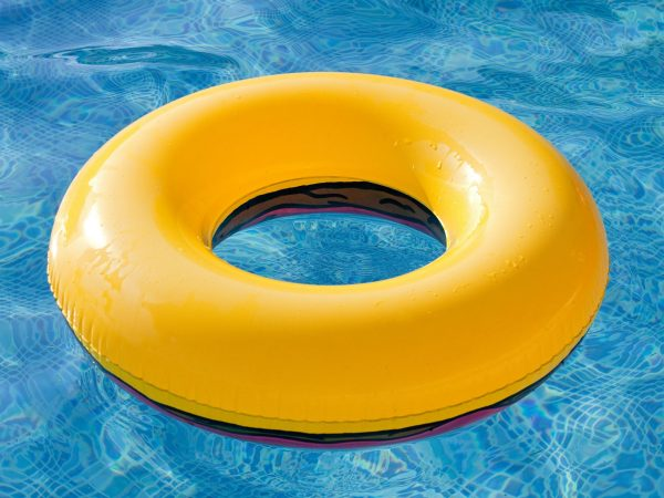 10037827 – yellow float floating in the pool with blue water