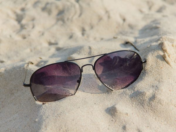 19275181 – sunglasses on the sand beach in south of thailand