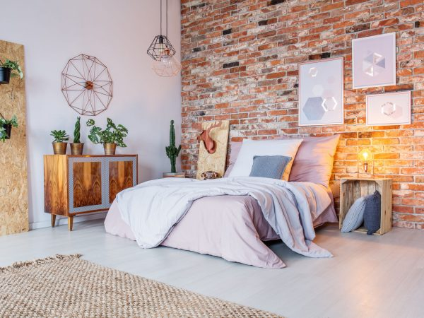 71353691 – bright bedroom with double bed, brick wall and rug