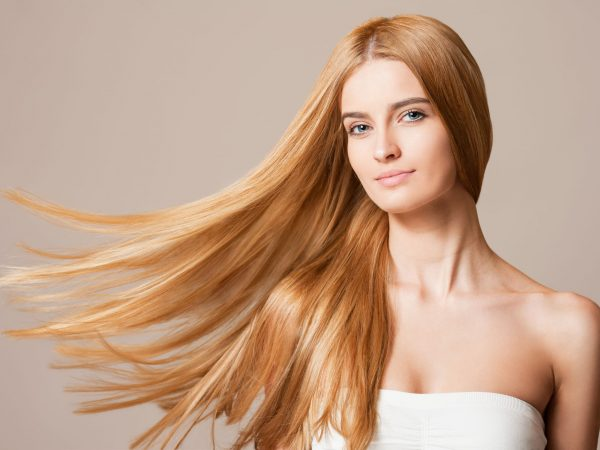 52411005 – portrait of a blond beauty with beautiful healthy long hair.