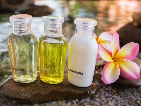 Mini set of bubble bath and shower gel decorated in zen style with pebble rock and flower with relaxing mood