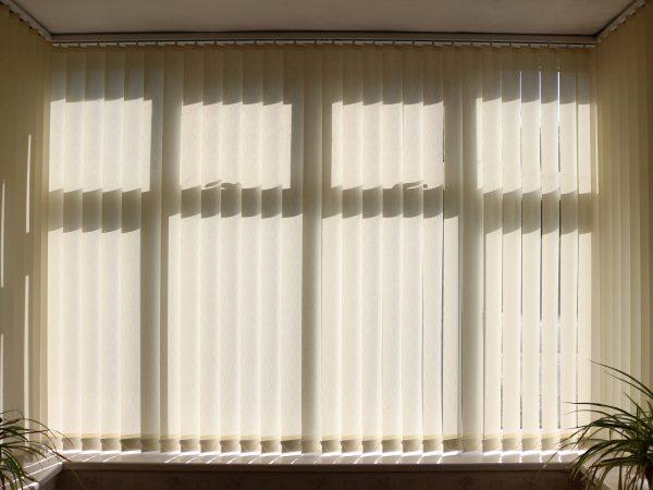Closed vertical venetian window blinds