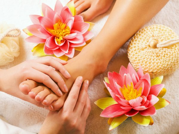 Woman enjoying a feet massage in a spa setting